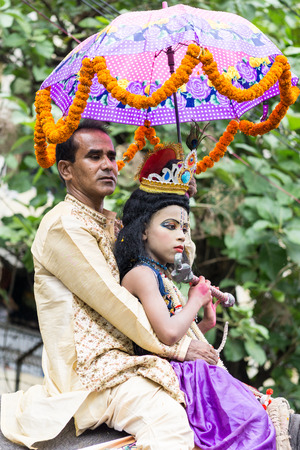 lord krishna: Dhaka, Bangladesh - September 04, 2015: A child dressed as Lord Krishna on the occasion of Janmashtami in Dhakeshwari Mandir, Dhaka, Bangladesh