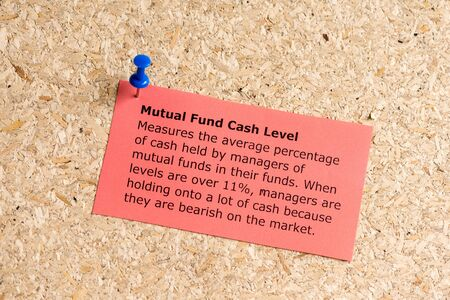 mutual fund: mutual fund cash level word typed on a paper and pinned to a cork notice board Stock Photo