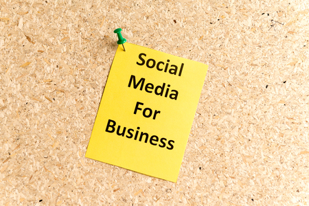 convivial: social media for business word typed on a paper and pinned to a cork notice board
