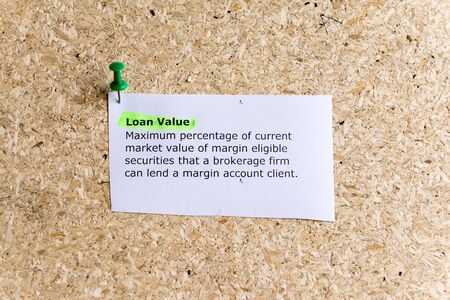 brokerage: loan value word typed on a paper and pinned to a cork notice board Stock Photo