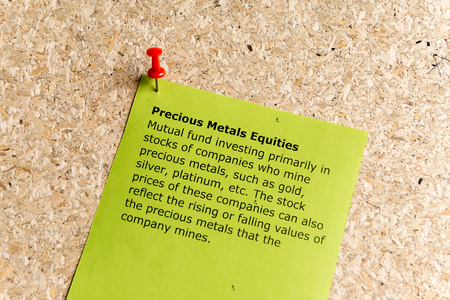 mutual fund: precious metals equities word typed on a paper and pinned to a cork notice board Stock Photo