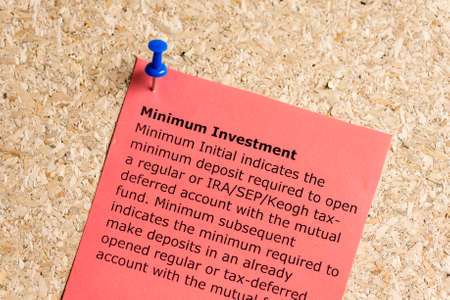 mutual fund: minimum investment word typed on a paper and pinned to a cork notice board