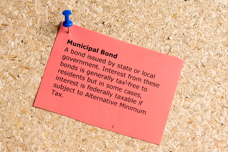 taxable: municipal bond word typed on a paper and pinned to a cork notice board