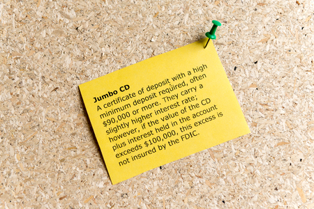 jumbo: jumbo cd word typed on a paper and pinned to a cork notice board