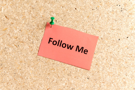 displace: follow me word typed on a paper and pinned to a cork notice board Stock Photo