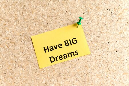 pinned: have big dreams word typed on a paper and pinned to a cork notice board Stock Photo