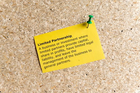 affiliation: limited partnership word typed on a paper and pinned to a cork notice board