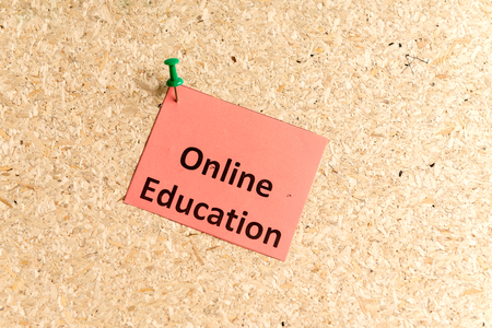 online education: online education word typed on a paper and pinned to a cork notice board