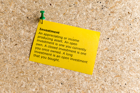 vested: investment word typed on a paper and pinned to a cork notice board