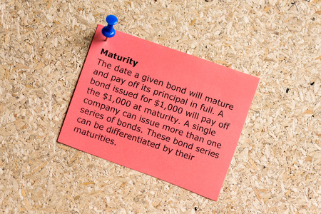 maturity: maturity word typed on a paper and pinned to a cork notice board Stock Photo