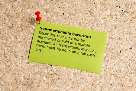 non cash: non marginable securities word typed on a paper and pinned to a cork notice board