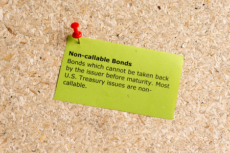 bonds: non callable bonds word typed on a paper and pinned to a cork notice board