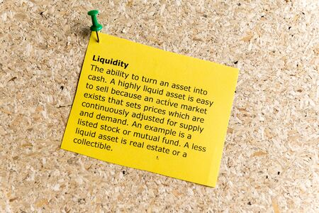adjusted: liquidity word typed on a paper and pinned to a cork notice board