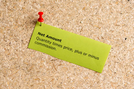 share prices: net amount word typed on a paper and pinned to a cork notice board