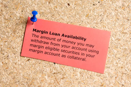 margine: Margin loan availibility word typed on a paper and pinned to a cork notice board