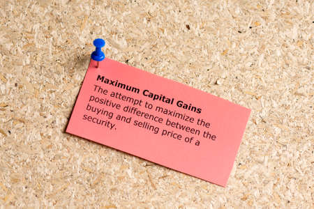 capital gains: maximam capital gains word typed on a paper and pinned to a cork notice board