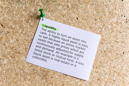 liquidity: liquidity word typed on a paper and pinned to a cork notice board