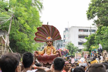 Dhaka, Bangladesh - September 04, 2015: A child dressed as Lord Krishna on the occasion of Janmashtami in Dhakeshwari Mandir, Dhaka, Bangladesh