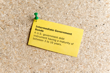 maturity: intermediate government bonds word typed on a paper and pinned to a cork notice board Stock Photo