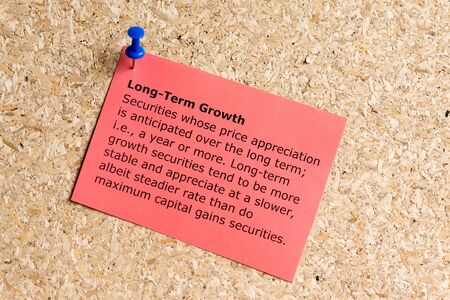 long term: long term growth word typed on a paper and pinned to a cork notice board Stock Photo