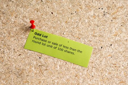 odd: odd lot word typed on a paper and pinned to a cork notice board Stock Photo