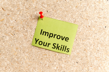 prowess: improve your skills word typed on a paper and pinned to a cork notice board