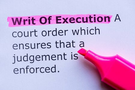 prescript: writ of execution  word highlighted on the white background Stock Photo