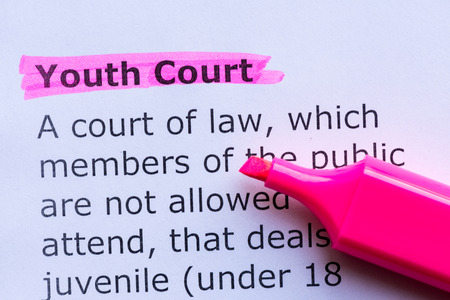 boyhood: youth court  word highlighted on the white background Stock Photo