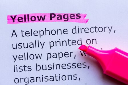 yellow pages: yellow pages  word highlighted on the white background