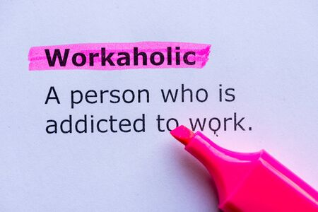 workaholic: workaholic  word highlighted on the white background