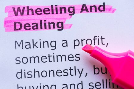 dealing: wheeling and dealing  word highlighted on the white background Stock Photo