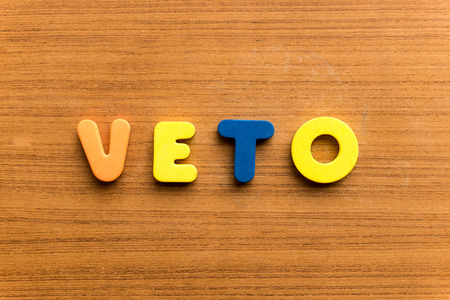 veto: veto  colorful word on the wooden background Stock Photo
