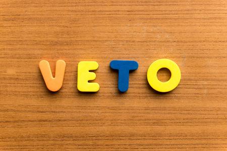 weta: veto  colorful word on the wooden background Zdjęcie Seryjne