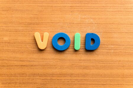 emptied: void  colorful word on the wooden background