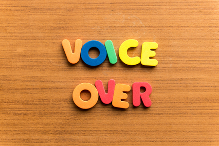 narration: voice over  colorful word on the wooden background Stock Photo
