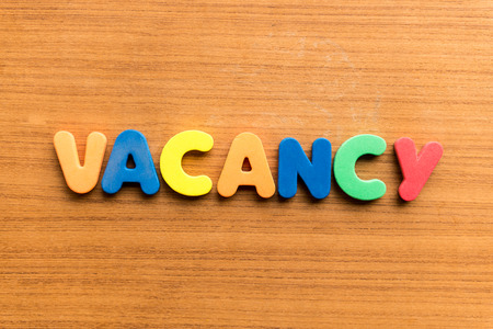 blankness: vacancy colorful word on the wooden background  colorful word on the wooden background