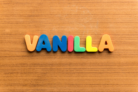 uncluttered: vanilla  colorful word on the wooden background