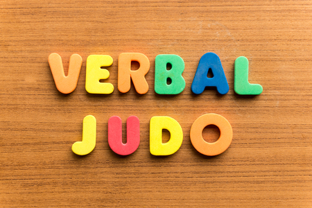 rhetorical: verbal judo  colorful word on the wooden background
