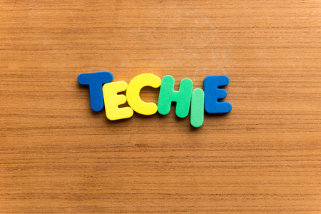 techie: techie  colorful word on the wooden background