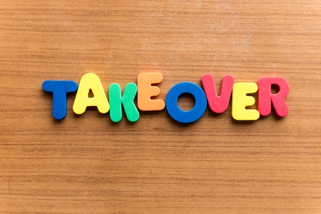 takeover: takeover  colorful word on the wooden background