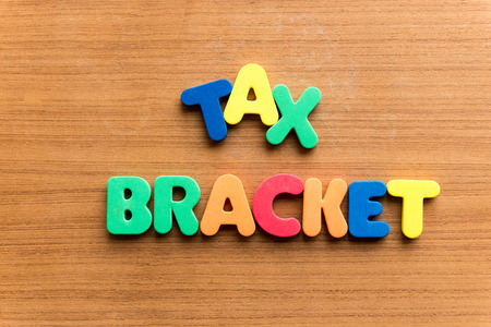 tax: tax bracket  colorful word on the wooden background Stock Photo