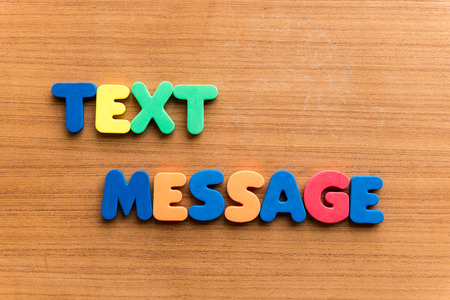stanza: text message  colorful word on the wooden background