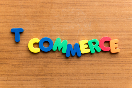 dealings: t commerce  colorful word on the wooden background Stock Photo