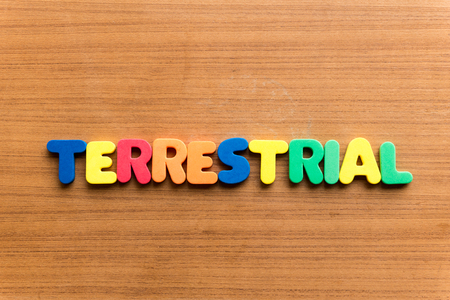 earthlike: terrestrial  colorful word on the wooden background
