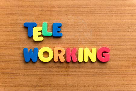 tele: tele working  colorful word on the wooden background Stock Photo