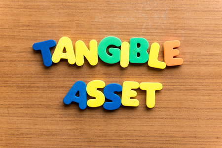 evident: tangible asset  colorful word on the wooden background