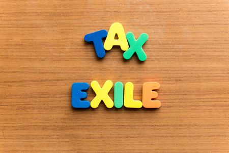 exile: tax exile  colorful word on the wooden background