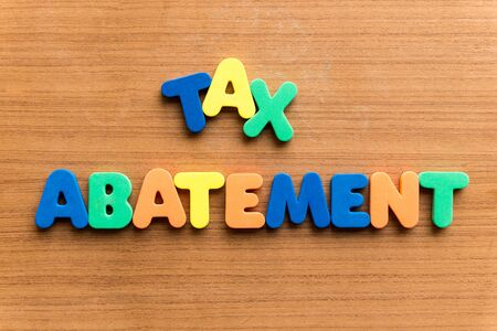 abatement: tax abatement  colorful word on the wooden background Stock Photo