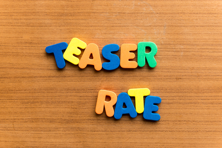 teaser rate  colorful word on the wooden background Stock Photo