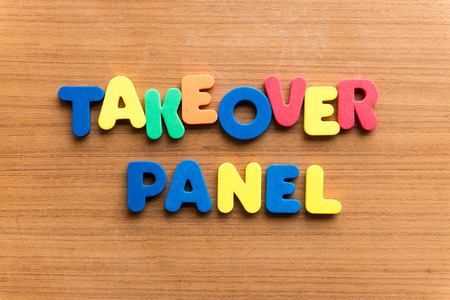 takeover: takeover panel  colorful word on the wooden background